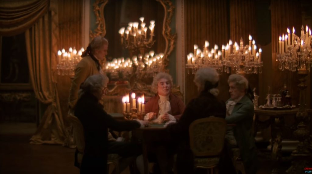 A dim candlelit scene from a movie