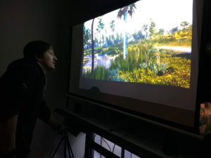 Figure 9. The Virtual UCF Arboretum is shown integrated with a treadmill and hand controllers. An undergraduate was grant funded in this interdisciplinary research.