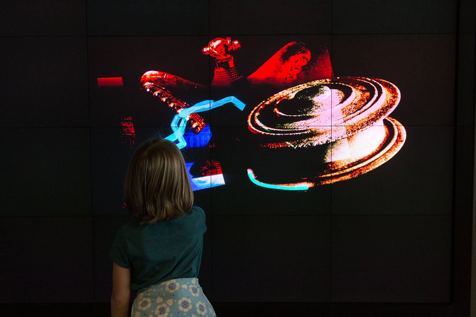 person stands in front of large screen
