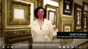Screenshot of a video shows a woman in front of frames