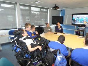 Centre Screen team members present an interactive screen design to a local school group of children.