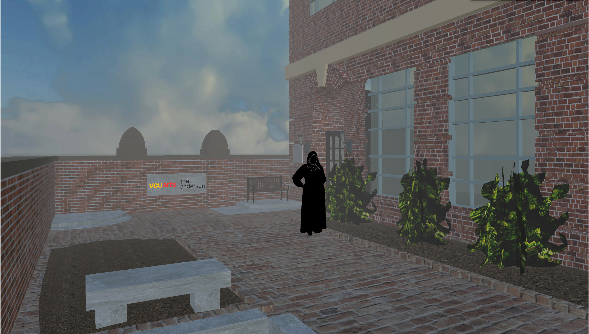 A person shown as a black silhouette standing outside the brick facade and courtyard of the Anderson.
