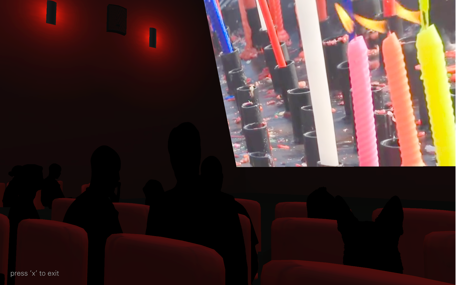 Darkened red-tinted interior of the Virtual Anderson Theater and a bright screen displaying multi-colored burning candles.