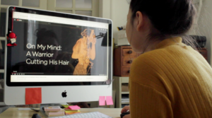 a girl watching a video on a computer screen